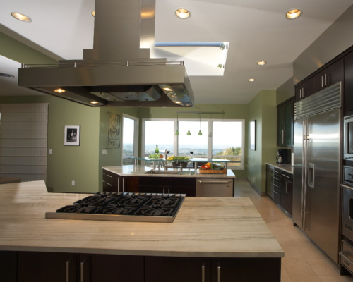 Marble Countertop With Stove and Stainless Steel Hood