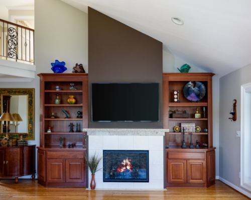 The new fireplace with existing bookcases