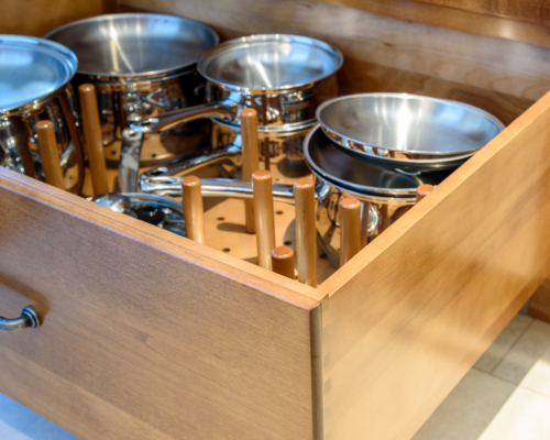 Organized, peg deep drawer storage for pots and pans