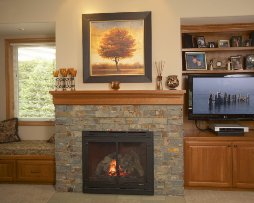 The New Fireplace With Built-in Bookshelf and Storage Bench