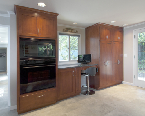 The beautiful double ovens and built-in desk area