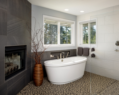 The newly remodeled fireplace and tub