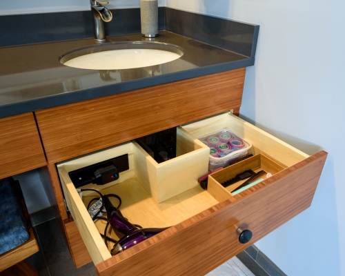 Undersink u-shaped drawers with interior outlet