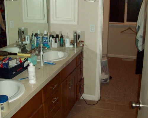 The previous master bathroom was dated and cluttered.