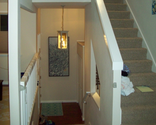Previous stairs were very white and closed off.