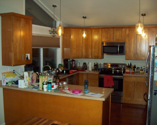 The cramped and cluttered kitchen.