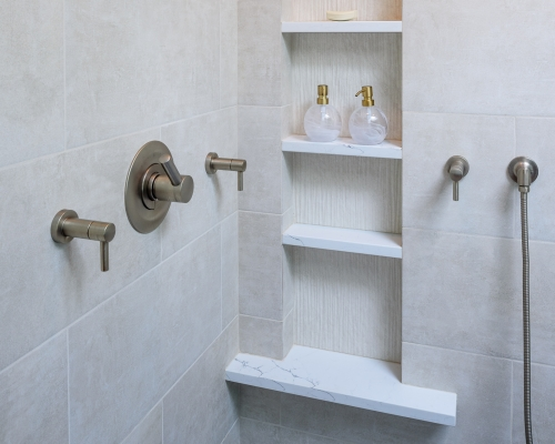 Large, four shelf niche in the shower.